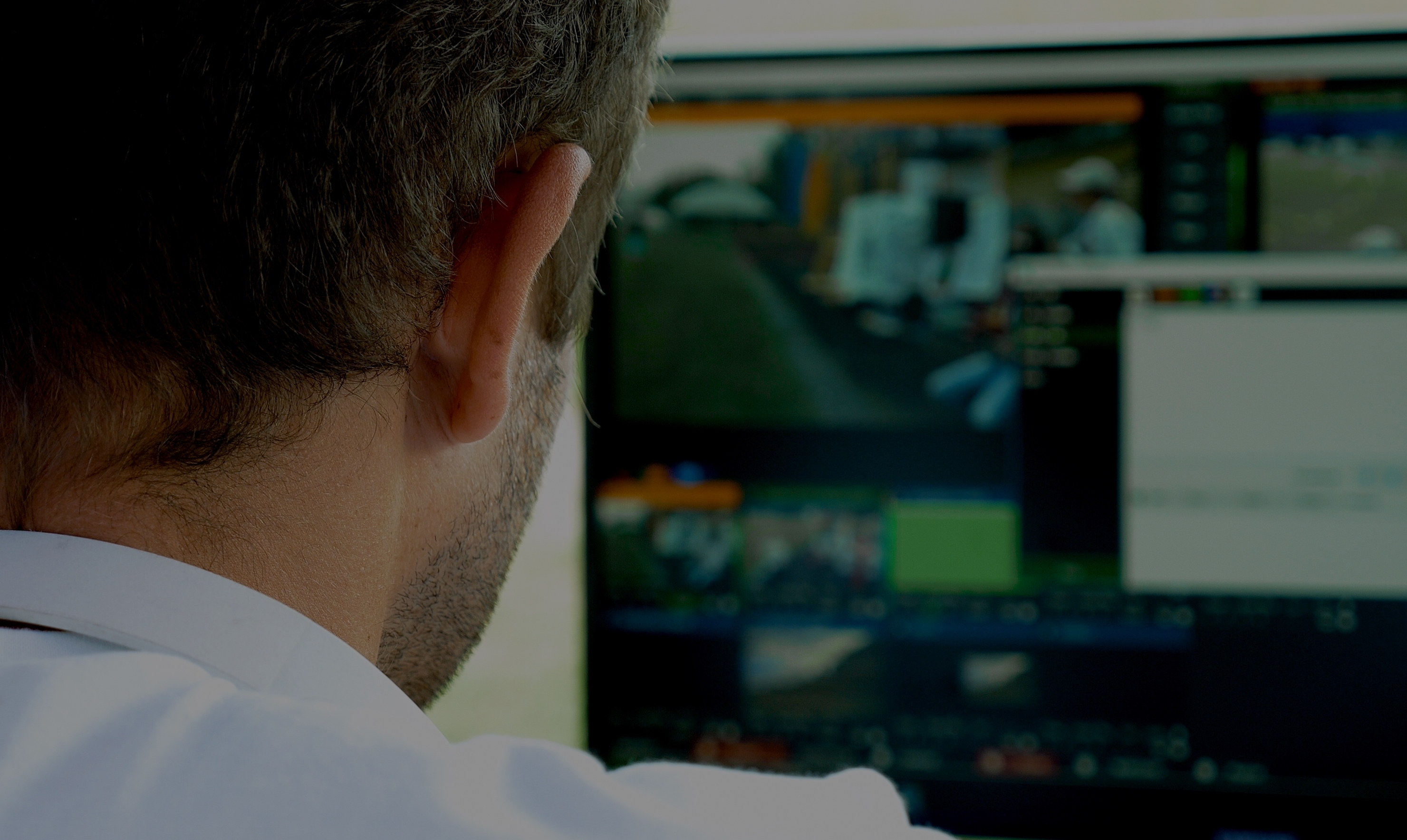 Video broadcast editor with headphones at screen 9 UZJNUR